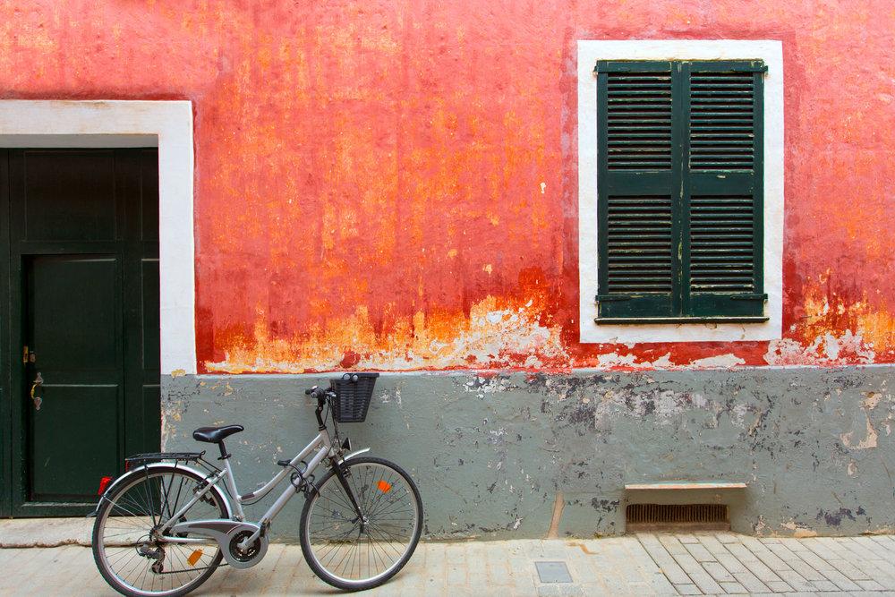 Menorca Ciutadella red grunge facade wit bicycle at Balearic islands.jpg
