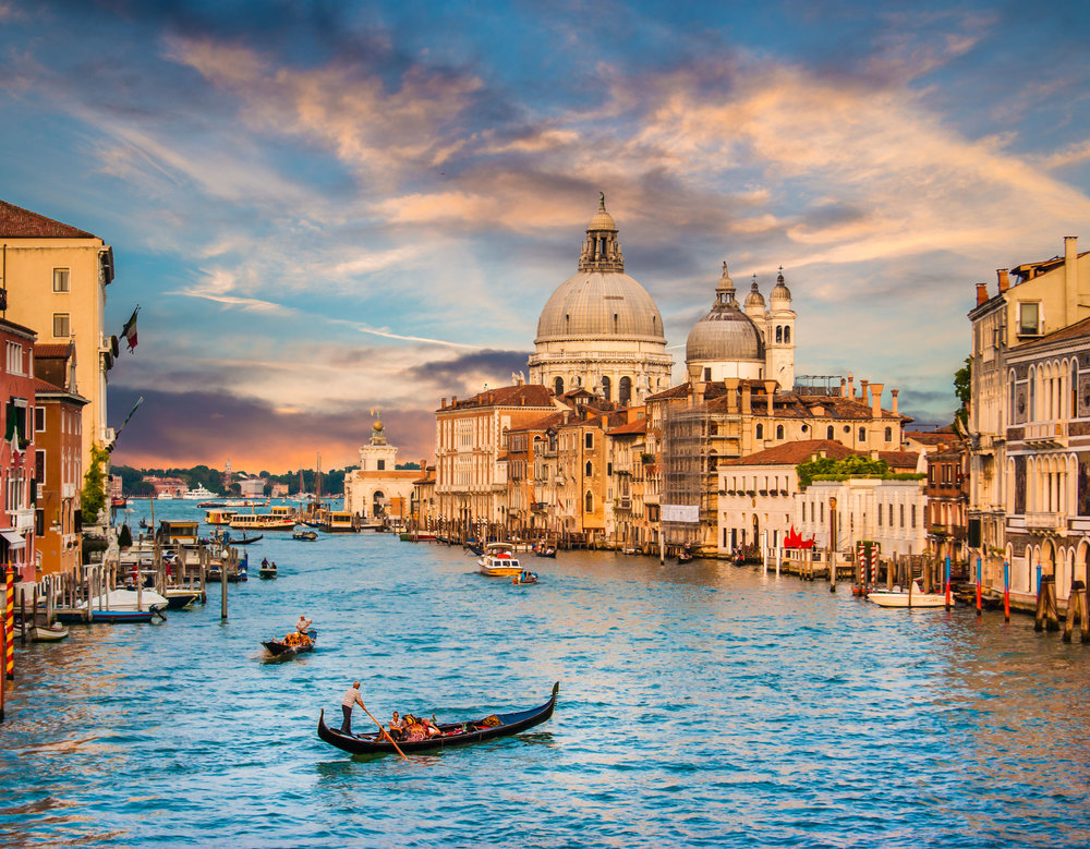Gondola on famous Grand Canal with Basilica di Santa Maria della Salute in golden evening light at sunset in Venice, Italy.jpg