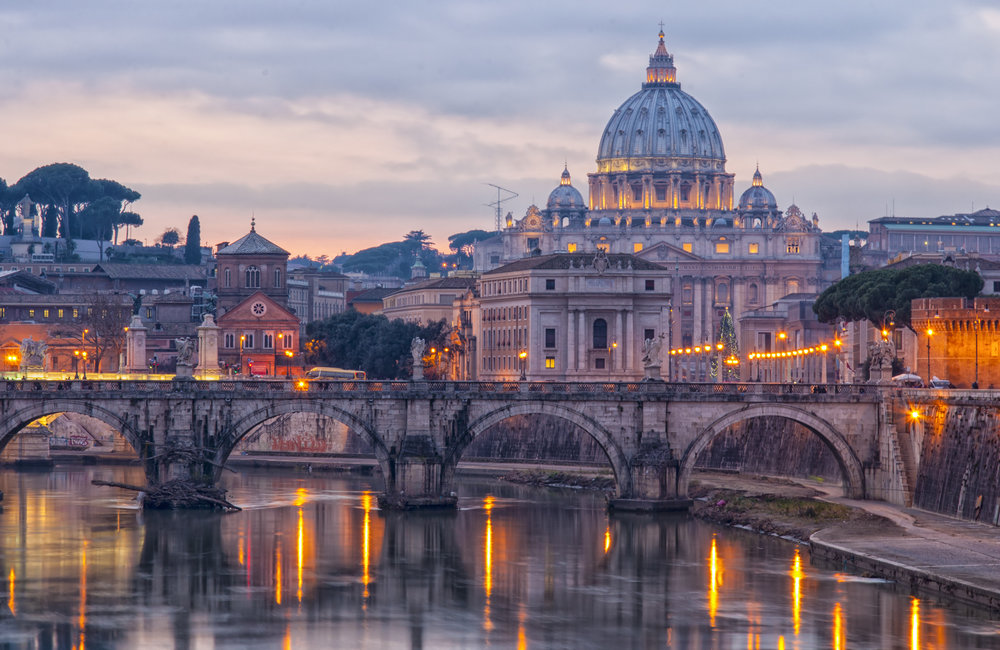 Vatican's basilica of Saint Peter at dusk reflecting on the river tiber situated in the Italien capital of Rome..jpg