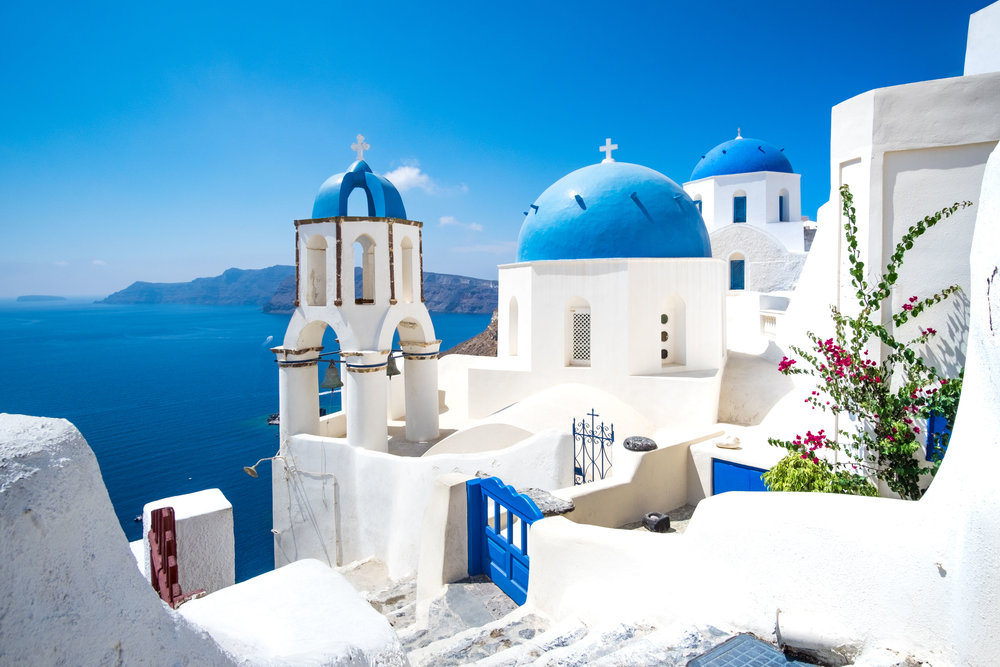 cycladic white houses and blue domes in Oia village.jpg