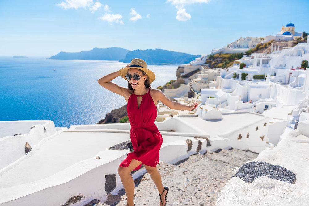 Woman Running Stairs Santorini, Greek Islands, Greec.jpg