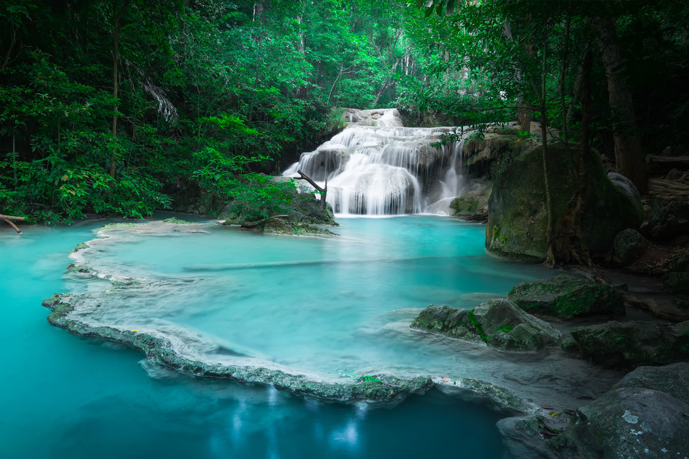 Jangle landscape with flowing turquoise water of Erawan cascade waterfall at deep tropical rain forest. National Park Kanchanaburi, Thaila.jpg
