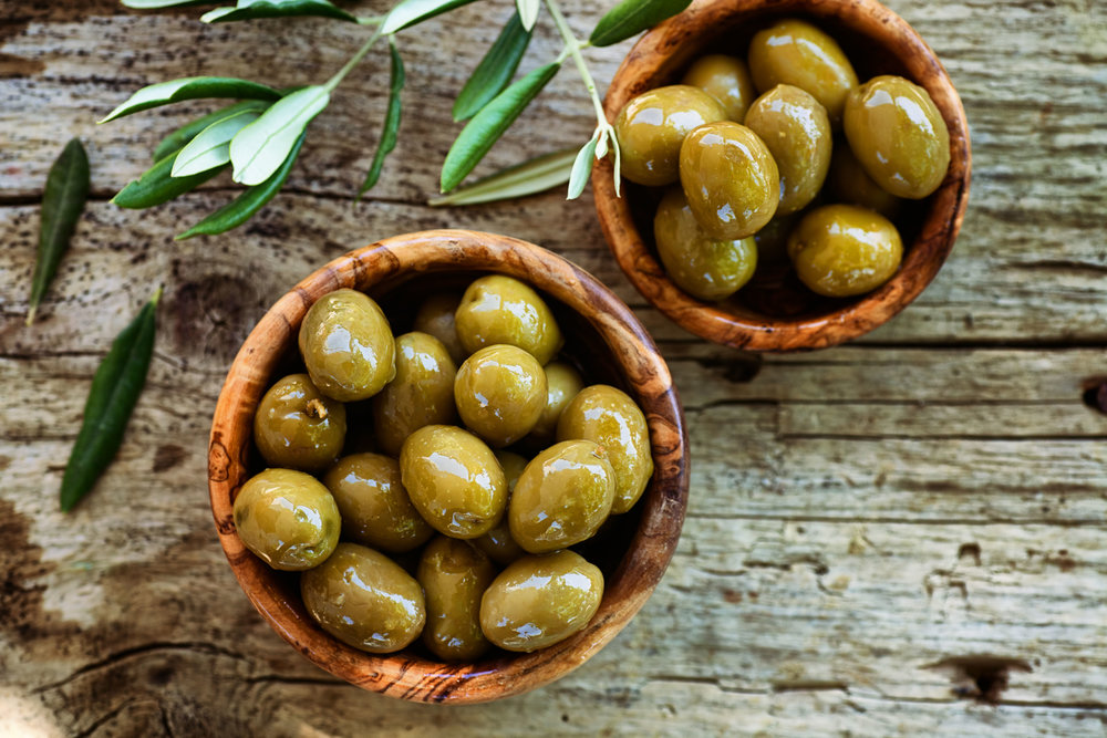 Fresh olives on rustic wooden background (olive, food).jpg