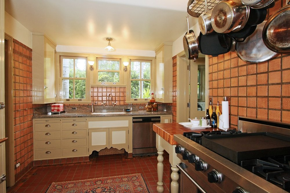 Kitchen with Cal art tile renovated to accommodate Viking stove and Bosch dishwasher.