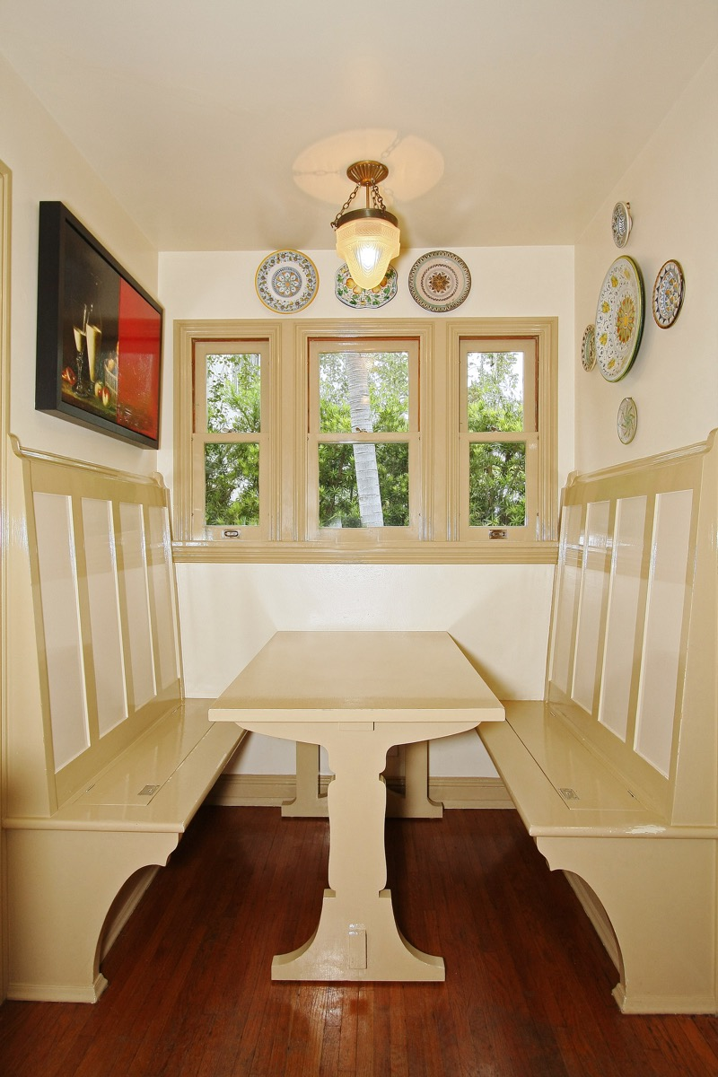The qaint butler's pantry with adjoining breakfast nook was dark and depressing. A small cabinet was removed and a double hung window was installed to allow more light in. A new table was built as per the original drawings except with the addition of a latch and wheels so the table could be removed to be cleaned under and also to more easily access the storage areas in the breakfast nook seats.