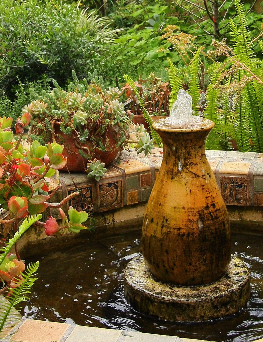 Hexagon fountain created with reproduction Batchelder tile with Gladding McBean vintage pot.
