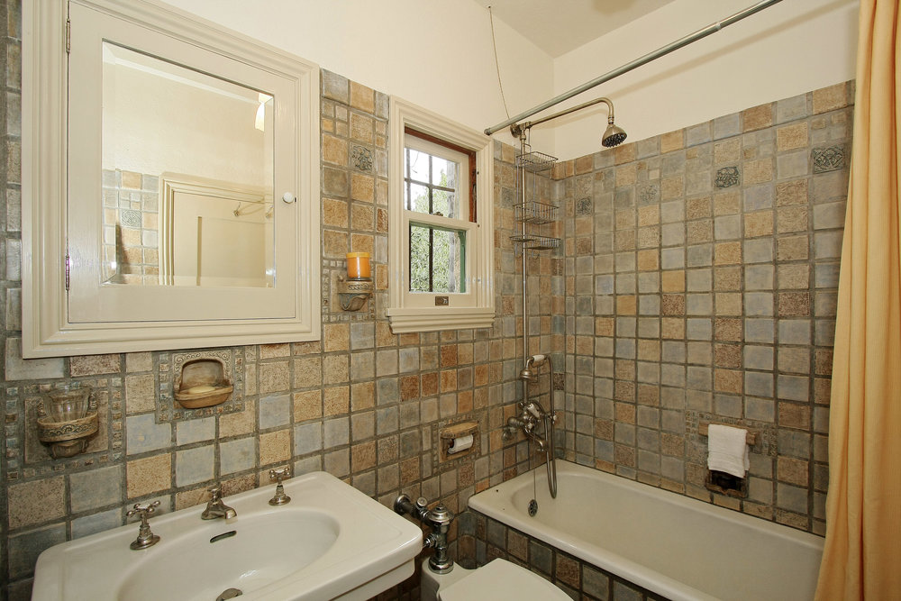 The original Batchelder tile, including rare pieces such as soap dishes, glass holders, and towel racks, were intact in both bathrooms. All the fixtures replaced those from the 1960's. Plastic and aluminum shower doors were removed exposing the tile and a more appropriate shower rod and curtain were installed.