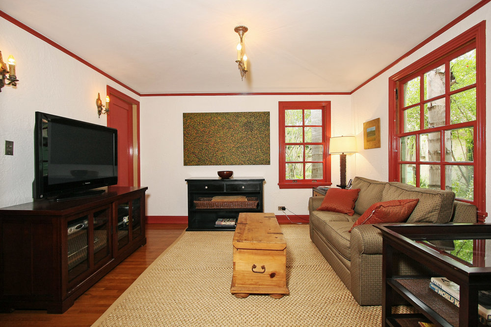 The entertainment room was once the breakfast room. It's location between the kitchen, dining, and living rooms make it an excellent place for the kids to hang out while parents prepare dinner. The paint is Benjamin Moore.