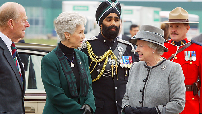 One of these people is a steely, cool-headed, war veteran with a big headdress. Everyone else calls her The Queen.