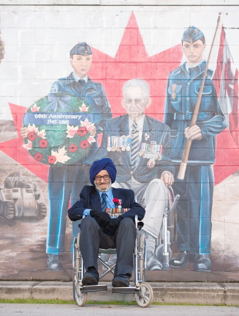 What's most surprising about this photo of Pritam Singh Juahal is R2D2 being included in the mural.