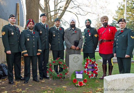 Sikh soldiers and RCMP at war grave.jpg