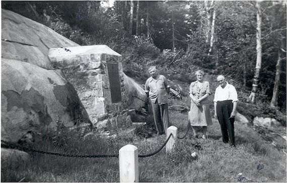 Milton and Elizabeth Jenkins at the cairn honouring their only child several weeks after the funeral. Photo credit: Veteran Affairs Canada.
