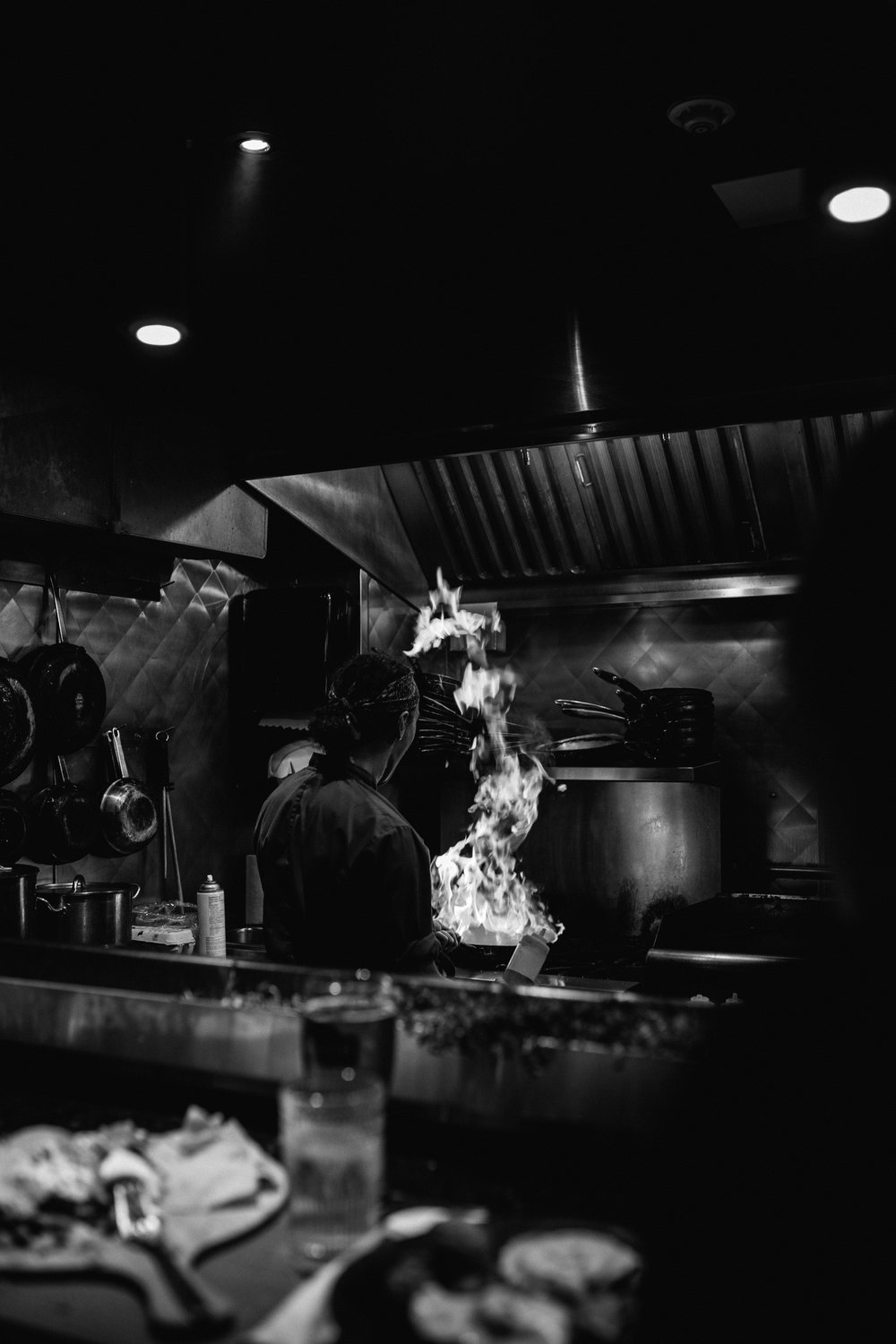 Former Brickhouse Sous Chef--now Fishbones head Chef, Blaze MacKinnion giving the people what they wanna see: FIRE!   Photo Credit: Al Douglas
