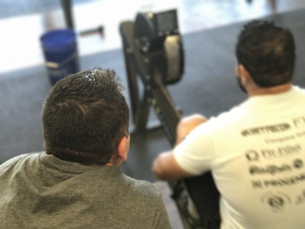 The Fit Stop CrossFit burpee over bar.JPG