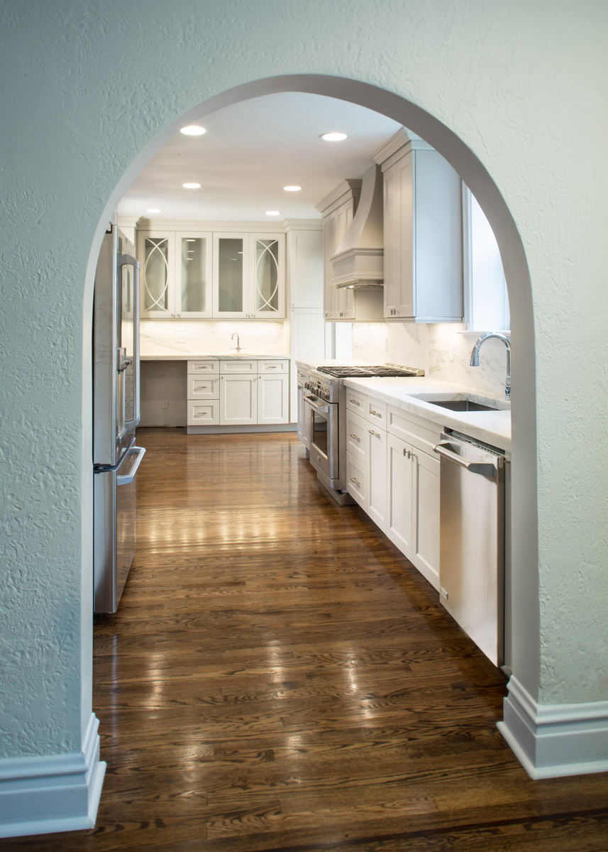 Custom Kitchen, Refinished Floors, Created Matching Archway