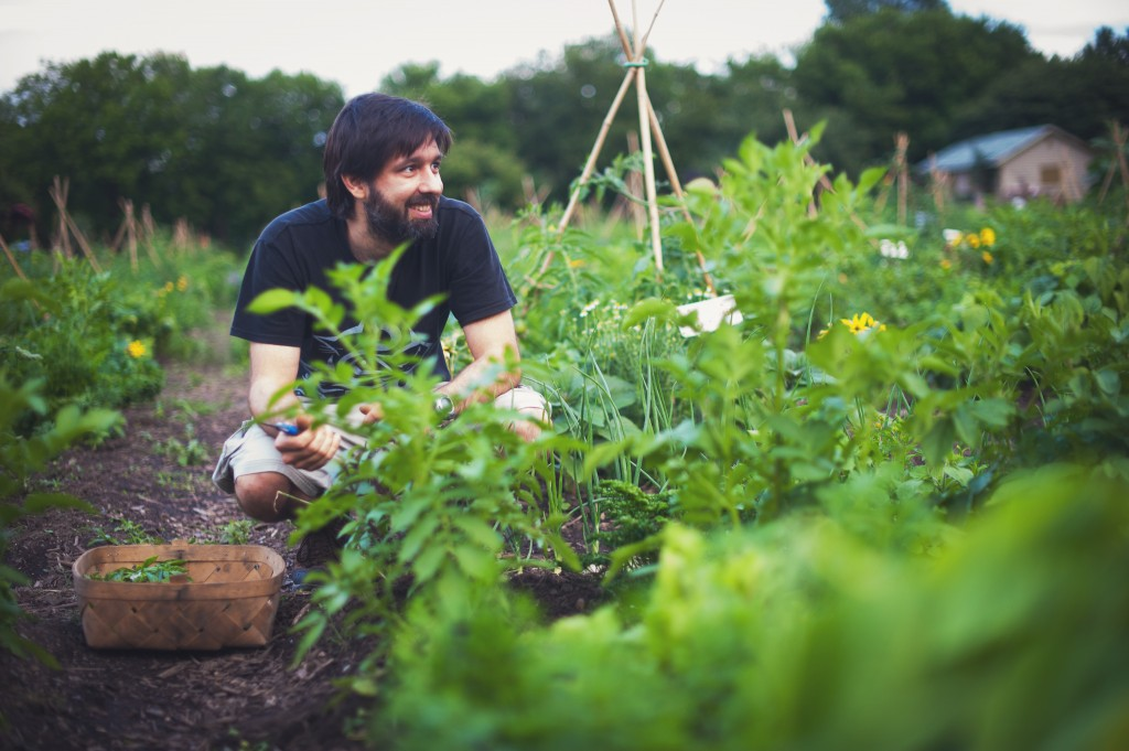man-smiling-gardening-montreal-botanical-garden-lifestyle-photography-alex-tran