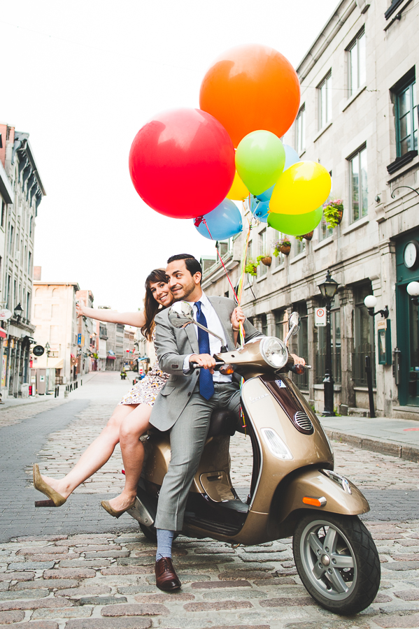 engagement-session-couple-on-vespa-balloons-montreal-old-port