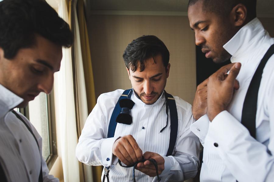 groom-groomsmen-preparing-bowtie-cufflinks