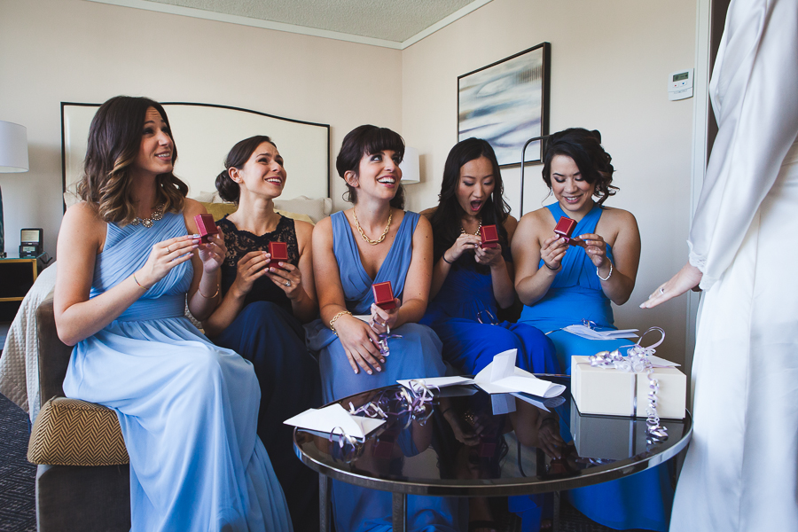 bridesmaids-reaction-opening-gifts-from-bride-montreal-omni-hotel-montreal-wedding-photographer
