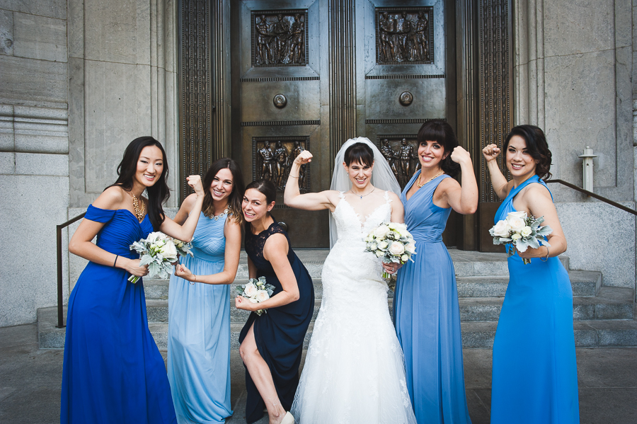 bridesmaids-bride-posing-flexing-muscles-montreal-old-port