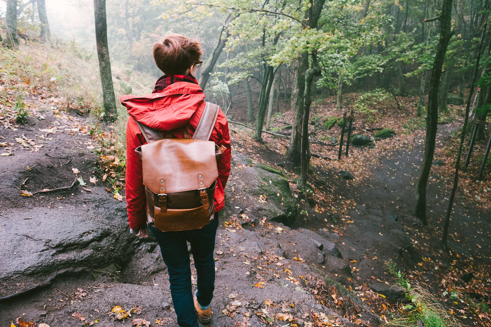 hiking-in-rain-with-backpack