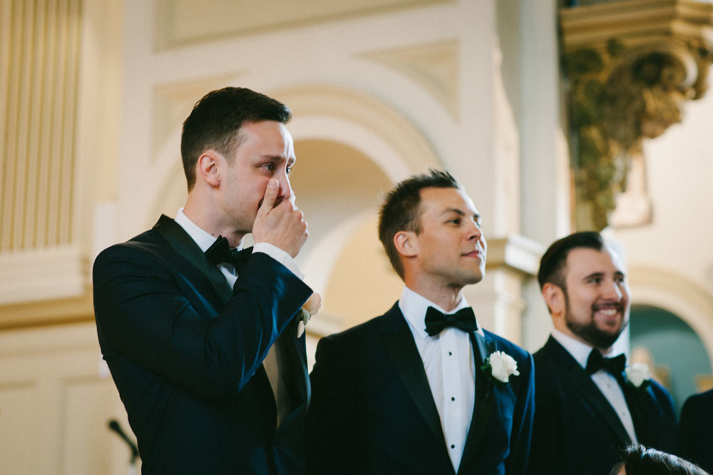groom-crying-first-look