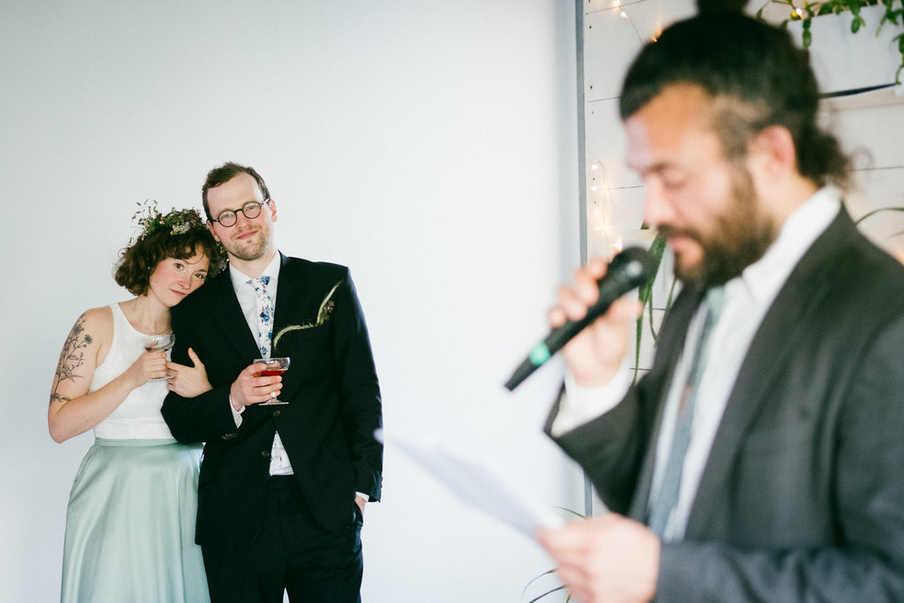 bride-and-groom-listening-speech-during-ceremony