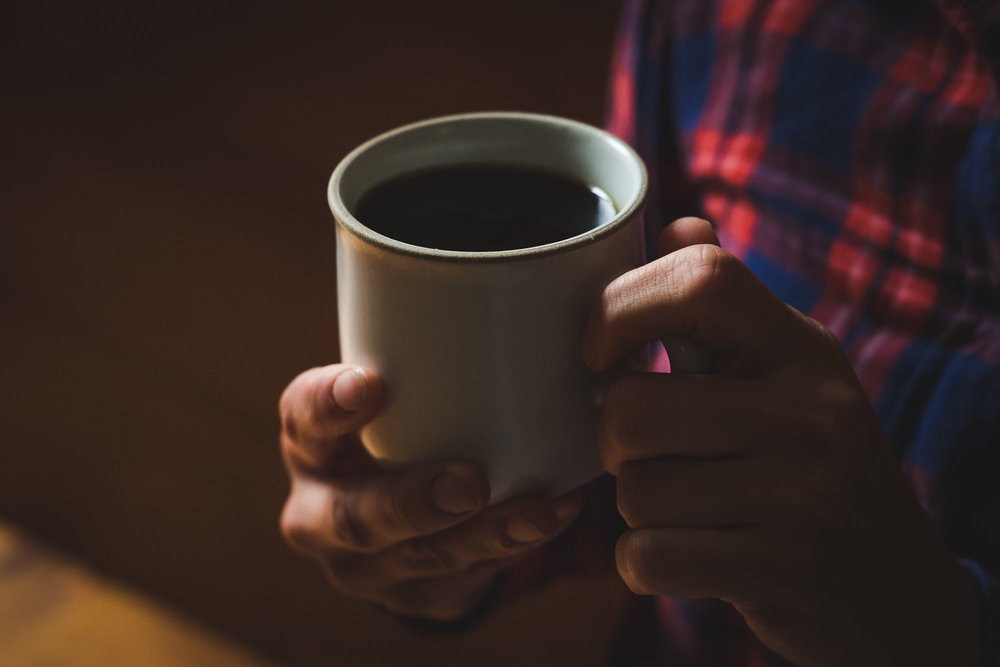 cup-of-coffee-close-up-on-hands