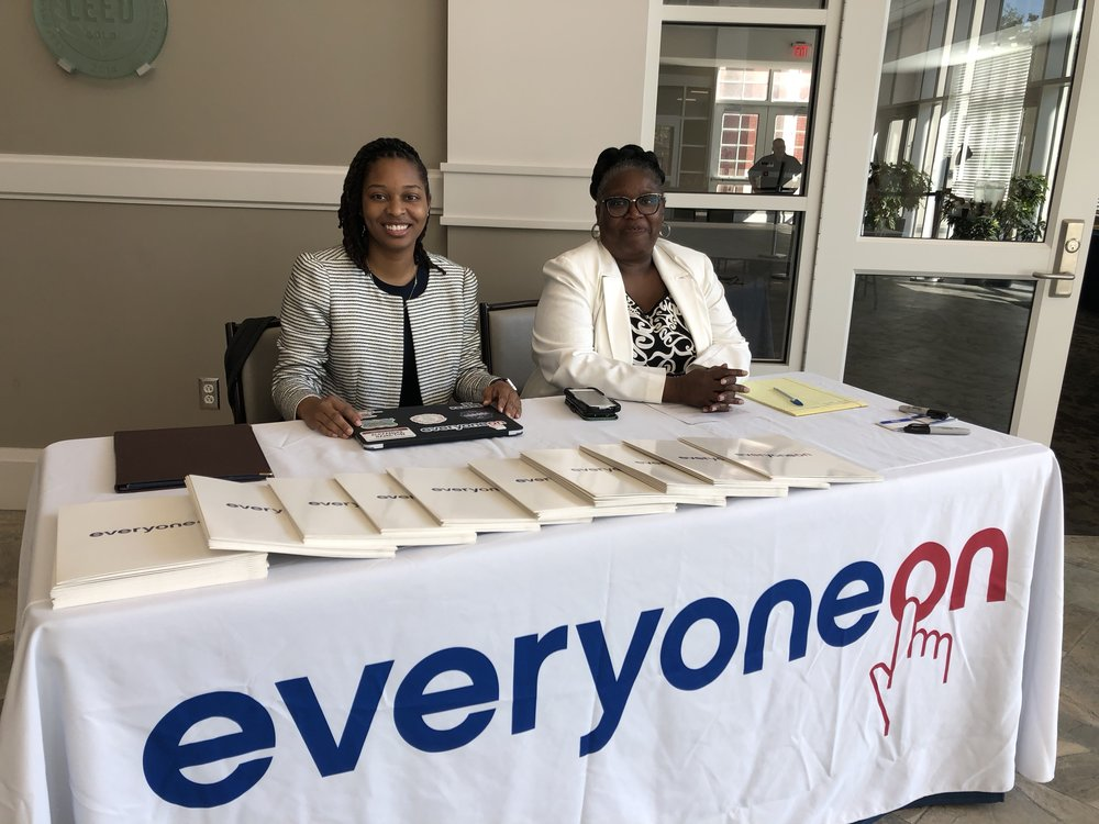 Amber Petty, Senior Manager, and J'Tanya Adams, Mid-Atlantic Regional Director welcome attendees as they arrive at the Levine Center for the summit.