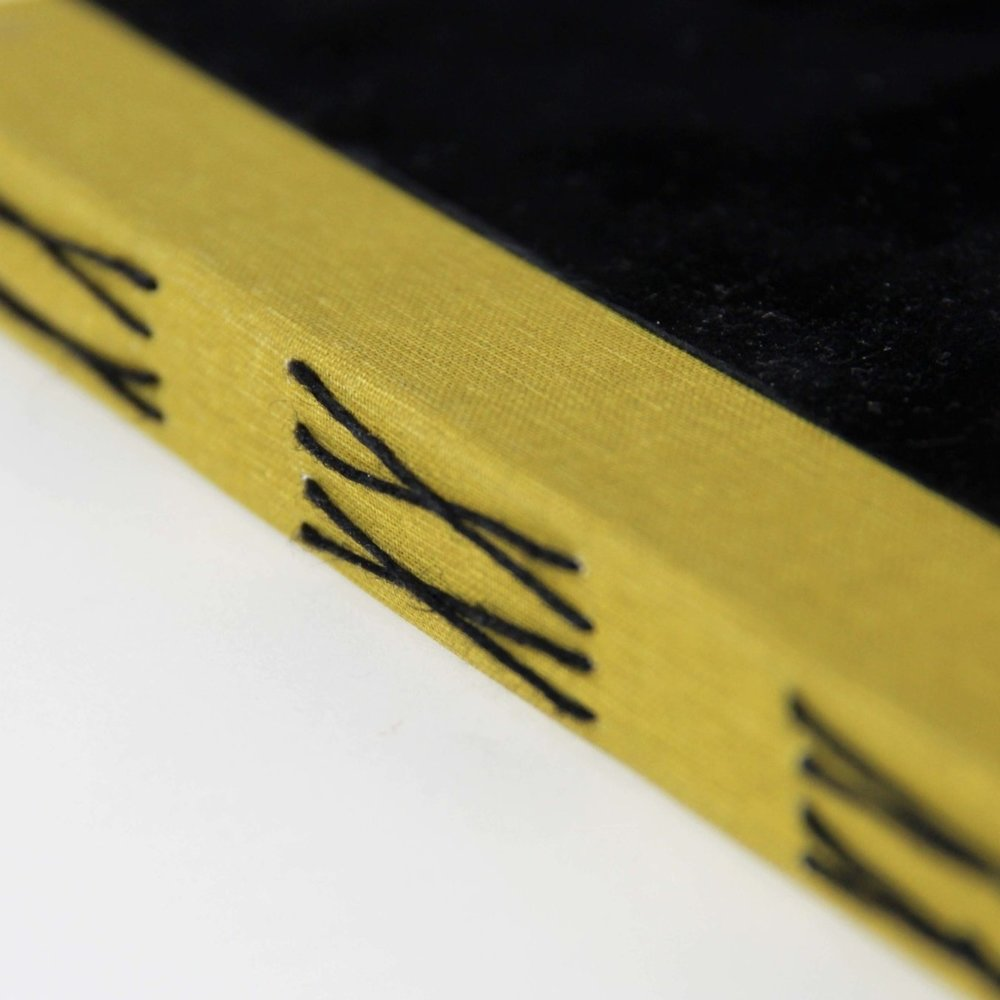 LONG STITCH - This adhesive free method also uses an exposed spine to make a feature of the sewing. Pages open completely flat, and the sewing can follow a simple or very elaborate pattern.+ Exposed sewing, clearly handmade+ Pages open 180+ degrees+ Coloured threads can be used- As there's no glue or spine lining, the book will remain 'soft' and the pages will shift a little- Not as sturdy as a book with a spine piece and spine linings- Edge decoration isn't possibleMin. pages – 8 pages/2 sectionsMax. pages – N/APrint set-up – in sections