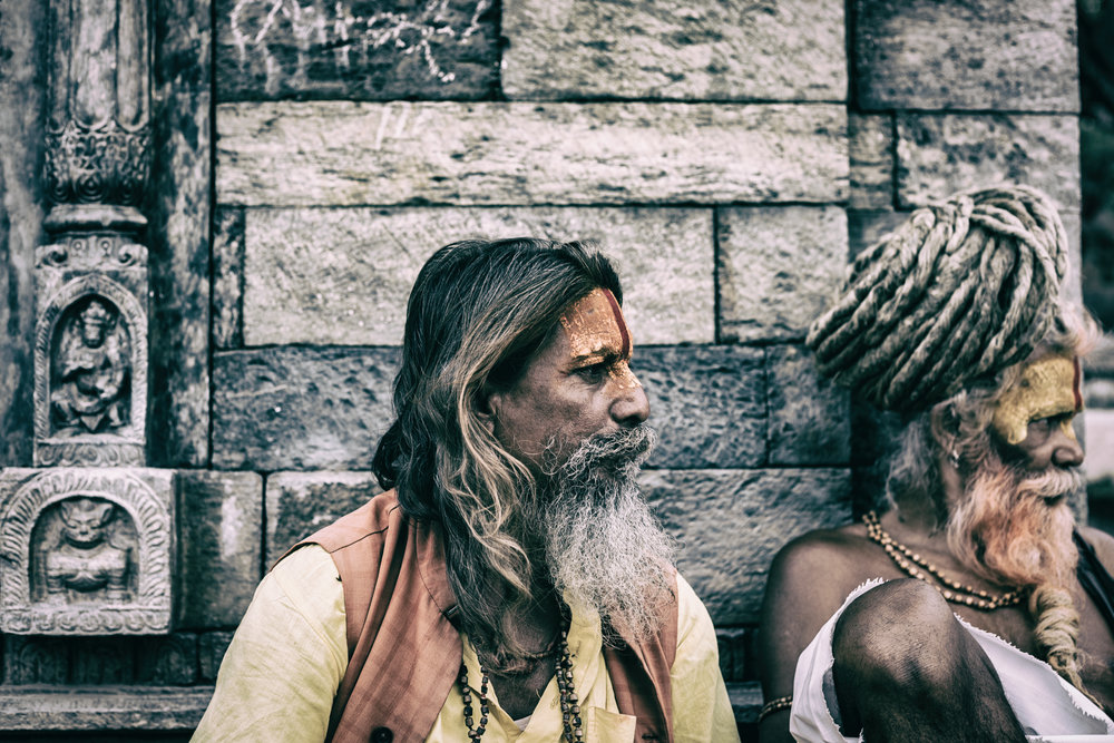 Sadhus matter of factly collect money from tourists eager for a photo or performance.
