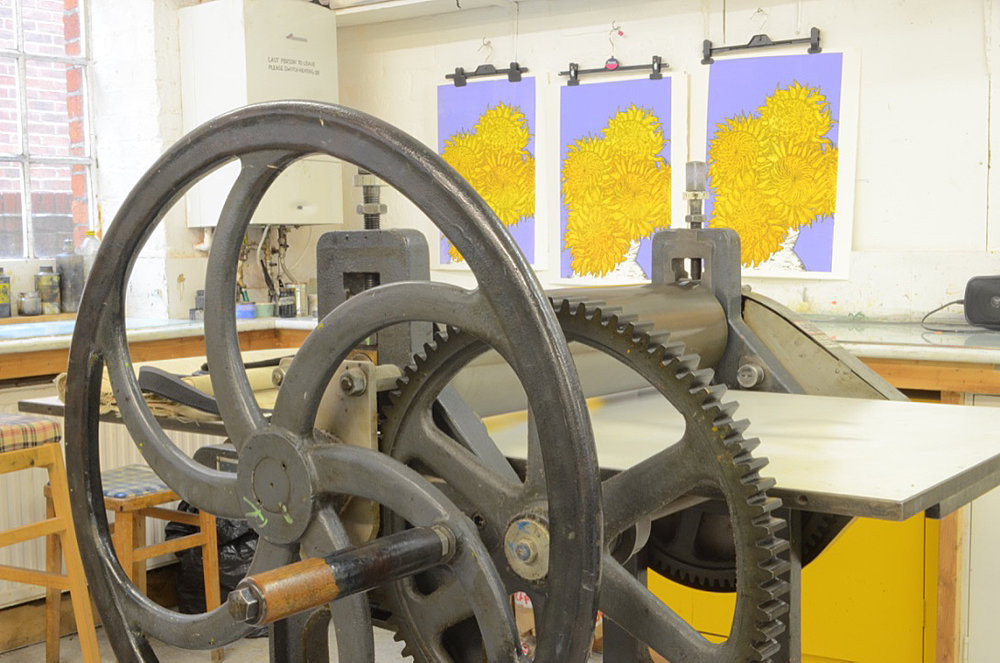 Yellow Rose Design Gallery | Letterpress for lino printing with printmaker Faisal Khouja's linocut prints at the background.
