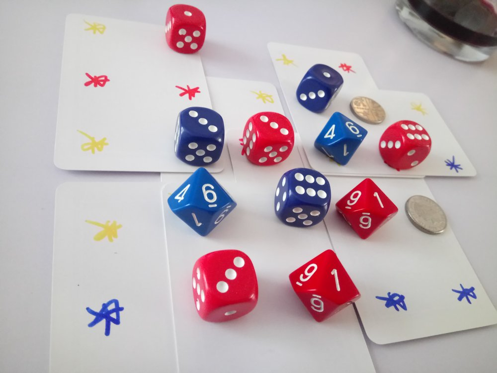 Yellow dice are needed in theory, but pretty much anything will do.