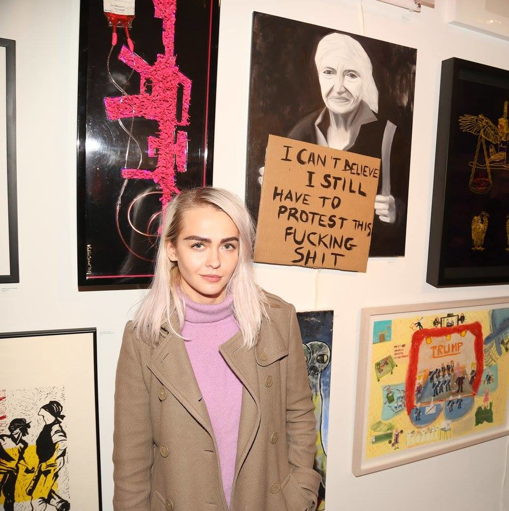 Olive Allen with her art at the Untitled Space Gallery