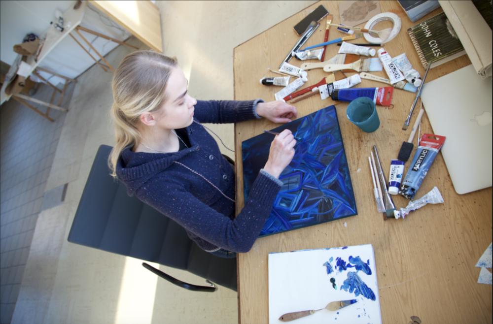 Olive Allen making artwork.png