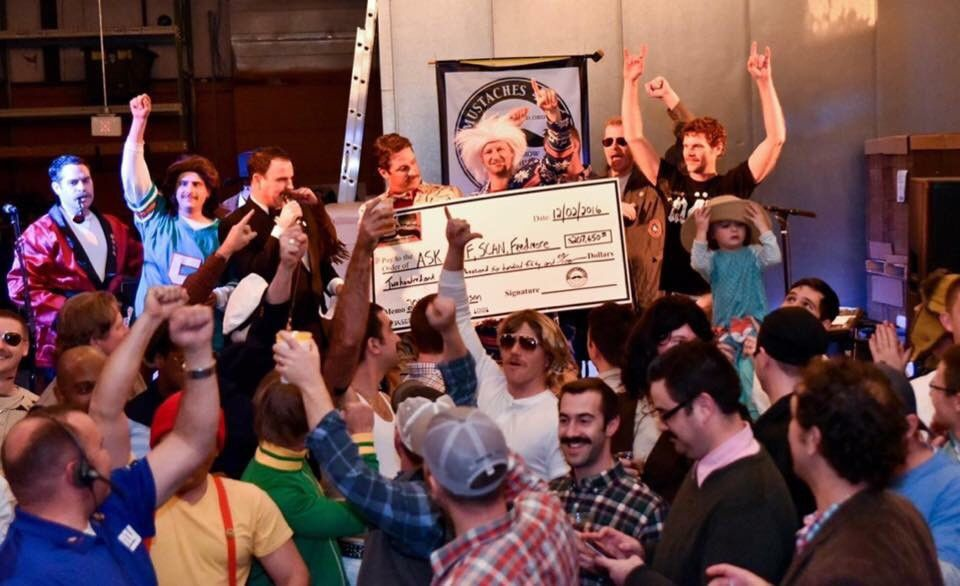 "Participants in the ""growing season"" with Mustache 4 Kids Richmond celebrate raising $207,000 for local children's causes at the culminating 'Stache Bash at Hardywood Park Craft Brewery. Karen Gage"