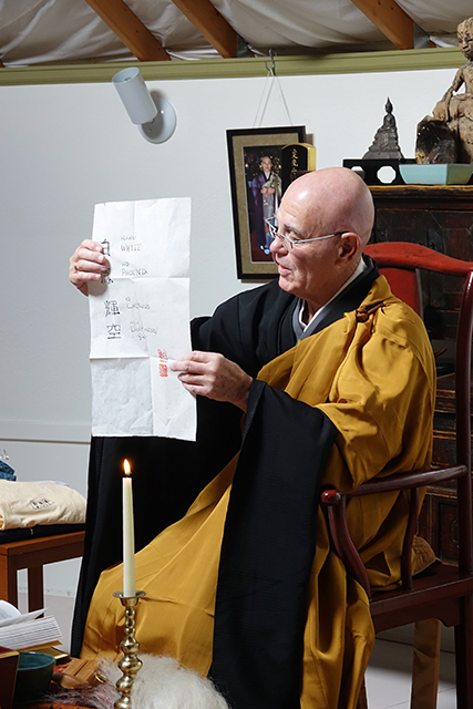 Daishin Sensei presents Kikuu with his dharma name.