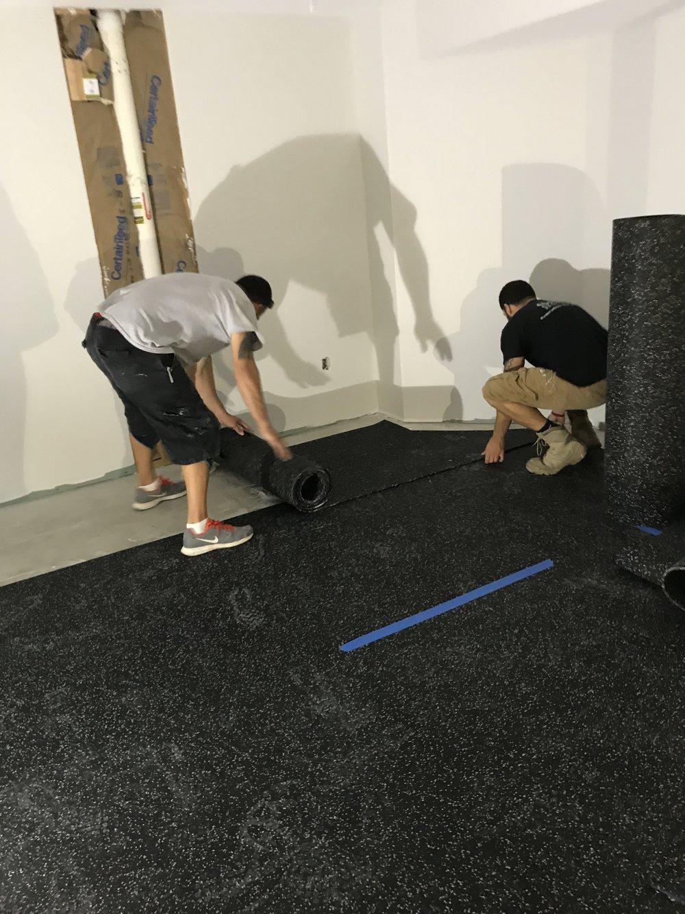 Shaw Remodeling - Progress photo - install flooring in basement finish gym area (1).JPG