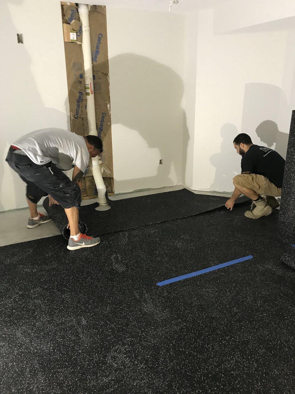 Shaw Remodeling - Progress photo - install flooring in basement finish gym area (2).JPG
