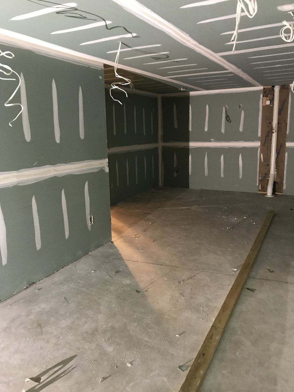 Shaw Remodeling - Progress photo - Drywall and taping in basement finish (2).JPG