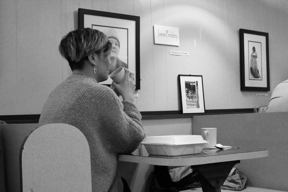 Un Jin sips a coffee at Tucker's Restaurant.