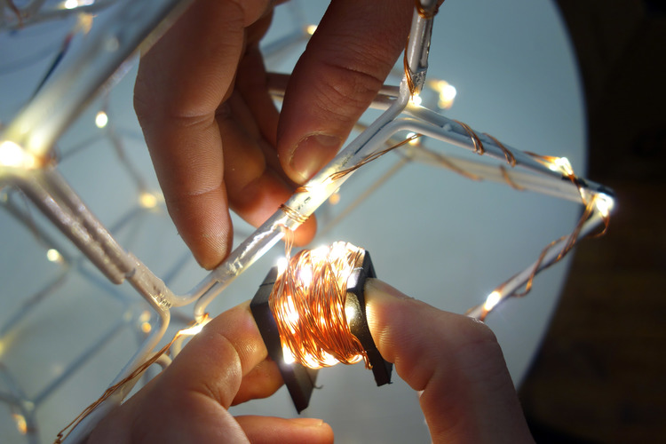 We coated our polyhedron with white spray paint and some LED copper string lights.
