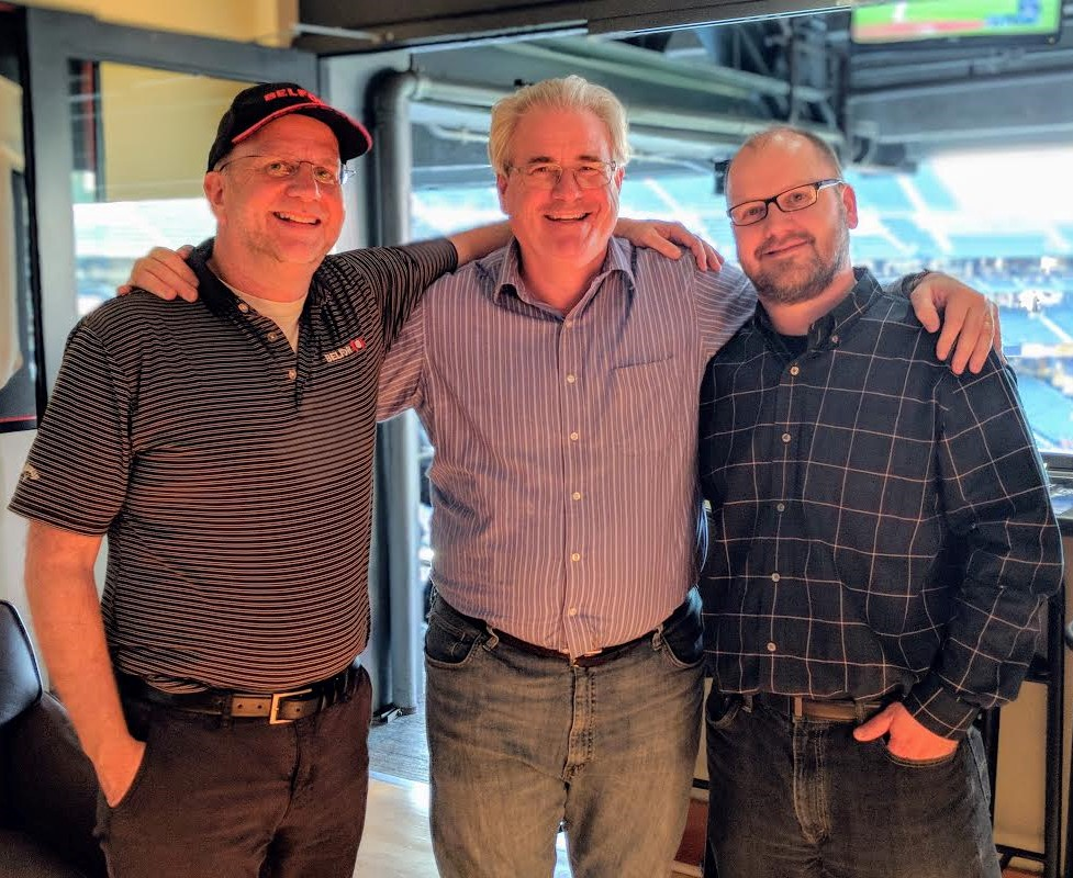 (from left to right) BELFOR's Kurt Daviscourt, THP President Deacon Patrick Moynihan, and Pacific Engineering Technologies' Mike Smith reunite at a Seattle Mariners game earlier this year.