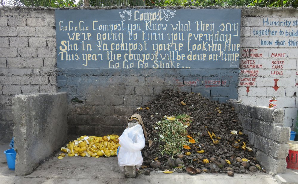 The Go Go Go Compost poem decorates the compost pile at Louverture Cleary School. The school has a long history of composting for its environmental benefits.