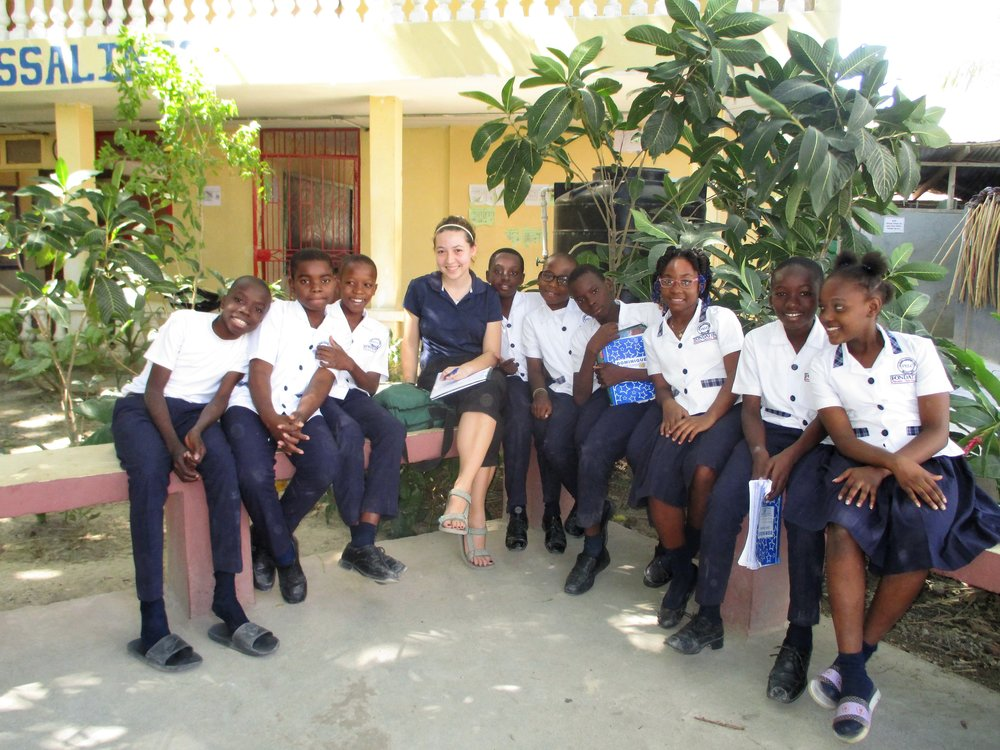 Volunteer Abigail Knapp with Louverture Cleary School Sizyem (US 7th grade) students.