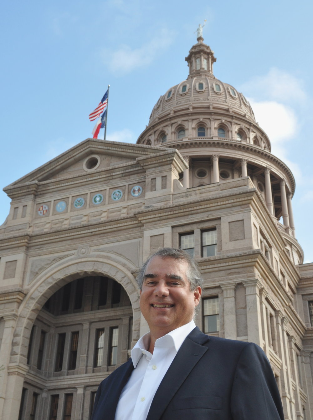 IITI Executive Director Richard May standing in front of the Texas Capitol