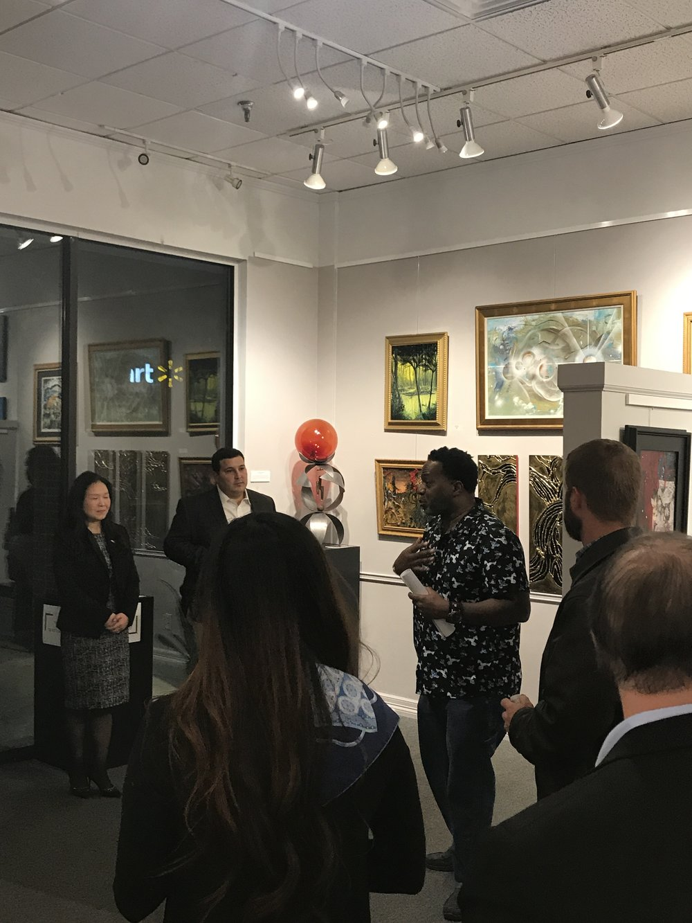 Military vet and artist Chris Van Loan, Sr. treat the holiday guests with an art tour of the current Austin ArtSpace exhibit.