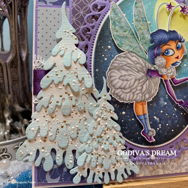 "Wintry Christmas Card ""Dance of the Snowflakes"" by Godiva's Dream. Christmas is most magical when there's freshly fallen snow around. I took inspiration from a quiet snowy night to create this wintry fairy card. Wrap up warm and continue reading to find out all the crafty details about this project. #cardmaking #handmadecard #handmadechristmas #christmascard #papercrafting"