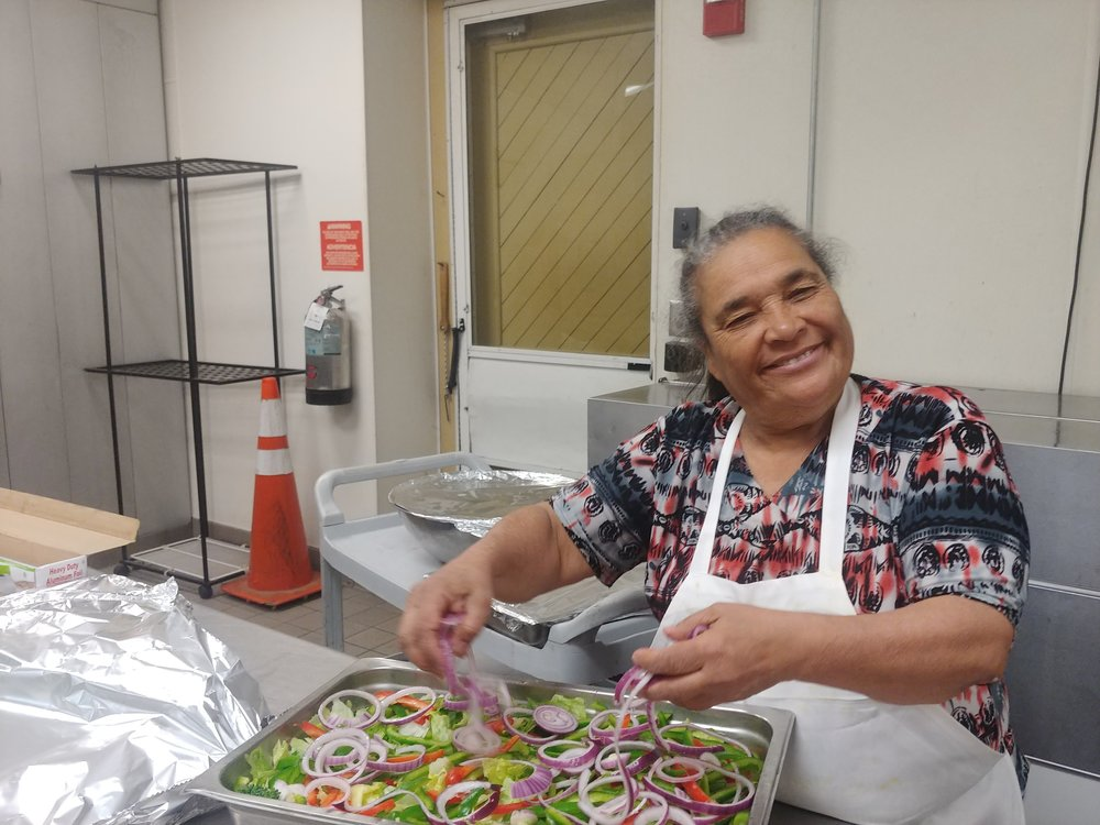 Francie Sierra, Legendary Acre Resident, volunteering at CHOP Dinner