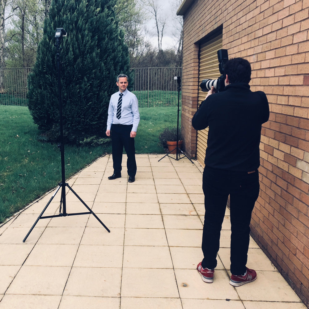 Andrew Perry takes photos of the Premier Labels team, starting with their MD, Gary Kerr